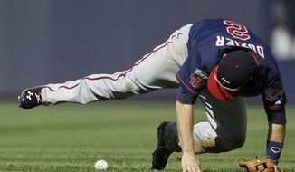 Minnesota Twins second baseman Brian Dozier (2) traps a ball hit by New York Yankees' Kelly Johnson for an RBI single during the eighth inning of a baseball game Saturday, May 31, 2014, in New York. The Yankees won the game 3-1. (AP Photo/Frank Franklin II)