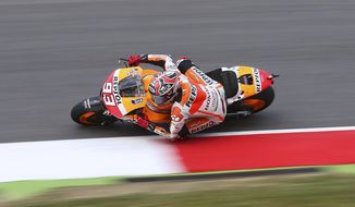 Spain's Marc Marquez steers his Honda during the third free practice session for Sunday's Italian Moto GP, at the Mugello race circuit, in Scarperia, Italy, Saturday, May 31, 2014. (AP Photo/Antonio Calanni)