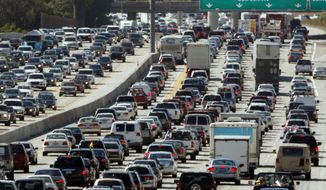FILE - This May 28, 2010, file photo shows traffic jammed in both directions on Interstate 405 on the Westside of Los Angeles. With people driving more fuel efficient cars and fewer miles some states are pondering the question of how to pay for roads funded largely with gas taxes, and many are watching Oregon's test of a tax on miles traveled. (AP Photo/Reed Saxon, File)