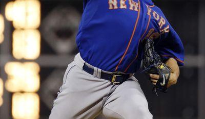New York Mets' Daisuke Matsuzaka, of Japan, pitches during the fourth inning of a baseball game against the Philadelphia Phillies, Friday, May 30, 2014, in Philadelphia. (AP Photo/Matt Slocum)