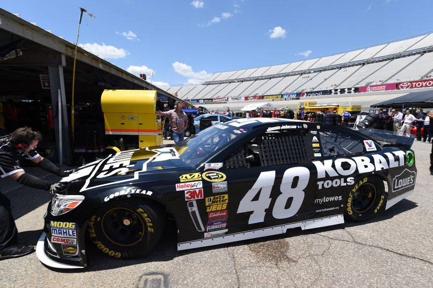 Jimmie Johnson's car is pushed out of the garage for practice for the NASCAR Sprint Cup series auto race, Saturday, May 31, 2014, at Dover International Speedway in Dover, Del. (AP Photo/Molly Riley)