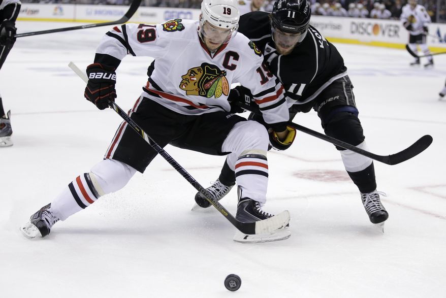 Chicago Blackhawks center Jonathan Toews, left, battles Los Angeles Kings center Anze Kopitar for the puck during first period of Game 6 of the Western Conference finals of the NHL hockey Stanley Cup playoffs in Los Angeles. Friday, May 30, 2014. (AP Photo/Chris Carlson)