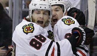 Chicago Blackhawks right wing Patrick Kane, left, celebrates his tie-breaking goal with center Andrew Shaw against the Los Angeles Kings during the third period of Game 6 of the Western Conference finals of the NHL hockey Stanley Cup playoffs in Los Angeles, Friday, May 30, 2014. The Blackhawks won 4-3. (AP Photo/Chris Carlson)