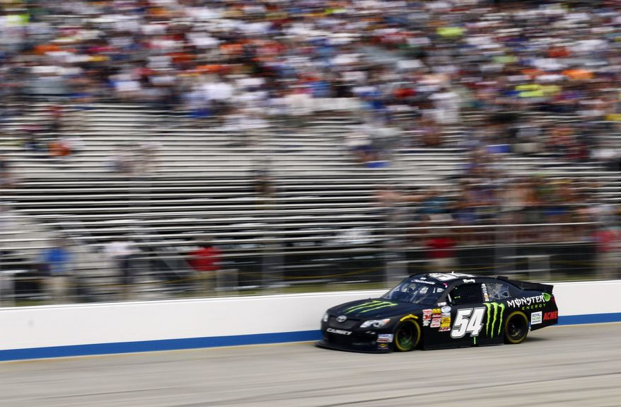 Kyle Busch drives during the the NASCAR Nationwide series auto race, Saturday, May 31, 2014, at Dover International Speedway in Dover, Del. Busch won the race.(AP Photo/Molly Riley)