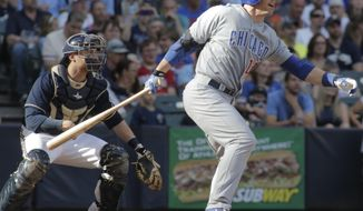 Chicago Cubs catcher John Baker hits an RBI single against the Milwaukee Brewers during the sixth inning of a baseball game Saturday, May 31, 2014, in Milwaukee. (AP Photo/Darren Hauck)