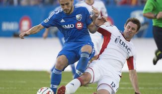 Montreal Impact's Issey Nakajima-Farran, left, battles for the ball against New England Revolution's Andy Dorman during first half MLS soccer action in Montreal, Saturday, May 31, 2014. (AP Photo/The Canadian Press, Graham Hughes)