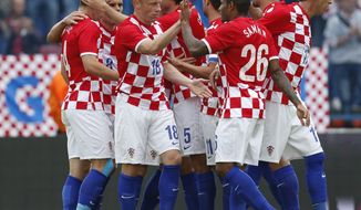 Croatia players celebrate their goal  during the international  friendly soccer  match between Croatia and Mali, in Osijek, Croatia, Saturday, May 31, 2014. (AP Photo/Darko Bandic)