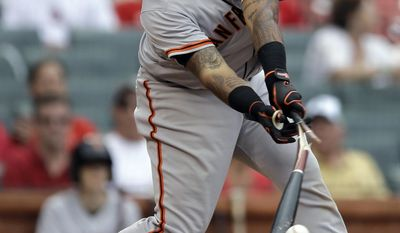 San Francisco Giants' Hector Sanchez breaks his bat on a line out to St. Louis Cardinals first baseman Allen Craig during the seventh inning of a baseball game Saturday, May 31, 2014, in St. Louis. The Cardinals won 2-0. (AP Photo/Jeff Roberson)