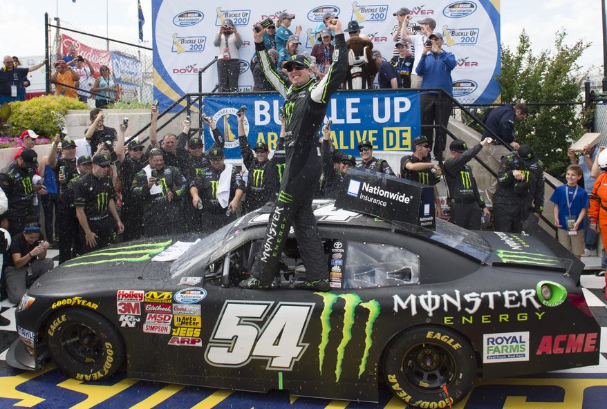 Kyle Busch celebrates in Victory Lane after winning the NASCAR Nationwide series auto race, Saturday, May 31, 2014, at Dover International Speedway in Dover, Del. (AP Photo/Molly Riley)