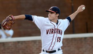 Virginia's Nathan Kirby pitches during the first inning of an NCAA college baseball regional tournament game against Arkansas in Charlottesville, Va., Saturday, May 31, 2014. (AP Photo/Pat Jarrett)