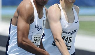 Lake Park's Lucas Bracher, left, takes the baton from teammate Lucas Bracher in the 3,200--meter relay during the preliminaries of the IHSA boys track and field meet Friday, May 30, 2014, in Charleston, Ill. (AP Photo/Daily Herald, Joe Lewnard)