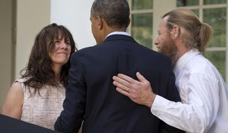 Parents of U.S. Army Sgt. Bowe Bergdahl, Jani Bergdahl, left, and Bob Bergdahl, turn to President Barack Obama after he spoke in the Rose Garden of the White House in Washington, Saturday, May 31, 2014, after the announcement that Bowe Bergdahl has been released from captivity in Afghanistan. Bergdahl, 28, had been held prisoner by the Taliban since June 30, 2009. He was handed over to U.S. special forces by the Taliban in exchange for the release of five Afghan detainees held by the United States. (AP Photo/Jacquelyn Martin)