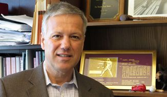 In this May 29, 2014 photo, Marquette University law school professor Matt Mitten poses in his office in Milwaukee. Mitten has been named the president-elect of the Sports Lawyers Association, a 1,700-member national organization of people who practice and teach sports law. (AP Photo, Dinesh Ramde)