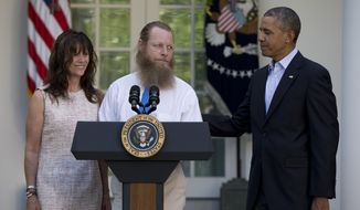 Accompanied by President Barack Obama, Jani Bergdahl and Bob Bergdahl speak during a news conference in the Rose Garden of the White House in Washington on Saturday, May 31, 2014 about the release of their son, U.S. Army Sgt. Bowe Bergdahl. Bergdahl, 28, had been held prisoner by the Taliban since June 30, 2009. He was handed over to U.S. special forces by the Taliban in exchange for the release of five Afghan detainees held by the United States. (AP Photo/Carolyn Kaster)