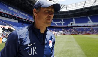 United States head coach Jurgen Klinsmann walks on the field during an open workout, Saturday, May 31, 2014, in Harrison, N.J. The United States are scheduled to Turkey in an international friendly soccer game on Sunday. (AP Photo/Julio Cortez)