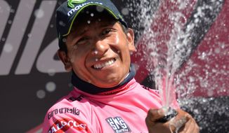 Colombia's Nairo Quintana sprays spaerkling wine on the podium after completing the 20th stage of the Giro d'Italia, Tour of Italy cycling race, from Maniago to Monte Zoncolan, Italy, Saturday, May 31, 2014. Nairo Quintana virtually clinched the Giro d'Italia title Saturday with a strong ride up the demanding Monte Zoncolan, while Michael Rogers benefited from a fan interruption to post his second stage victory of the race. (AP Photo/Gian Mattia D'Alberto)