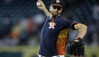 Houston Astros pitcher Scott Feldman throws during the first inning of a baseball game against the Baltimore Orioles, Sunday, June 1, 2014, in Houston. (AP Photo/Patric Schneider)