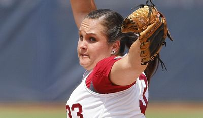 Alabama starting pitcher Jaclyn Traina throws against Oregon during the first inning of an NCAA Women's College World Series softball tournament game in Oklahoma City, Sunday, June 1, 2014. (AP Photo/Alonzo Adams)