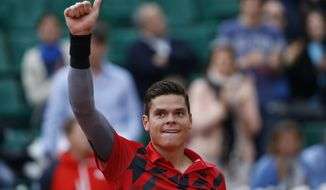 Canada's Milos Raonic celebrates winning the fourth round match of the French Open tennis tournament against Spain's Marcel Granollers at the Roland Garros stadium, in Paris, France, Sunday, June 1, 2014. Raonic won in three sets 6-3, 6-3, 6-3. (AP Photo/Darko Vojinovic)