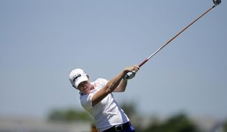 Stacy Lewis hits a tee shot on the second hole during the final round of the ShopRite LPGA Classic golf tournament in Galloway Township, N.J., Sunday, June 1, 2014. (AP Photo/Mel Evans)
