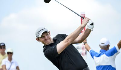 Stephen Gallacher of Britain tees off from the first hole during the final round of the Nordea Masters at PGA National, in Malmo, southern Sweden, Sunday, June 1, 2014. (AP Photo/TT, Anders Wiklund) SWEDEN OUT