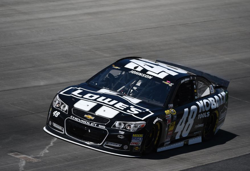 Jimmie Johnson drives during the NASCAR Sprint Cup series auto race, Sunday, June 1, 2014, at Dover International Speedway in Dover, Del. (AP Photo/Molly Riley)