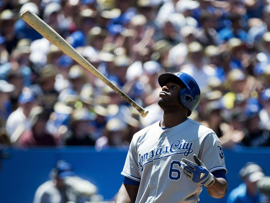 Kansas City Royals' Lorenzo Cain tosses his bat in the air after striking out against the Toronto Blue Jays during the fourth inning of a baseball game in Toronto on Sunday, June 1, 2014. (AP Photo/The Canadian Press, Nathan Denette)
