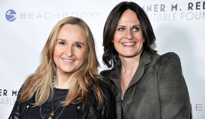 FILE - Melissa Etheridge, left, and Linda Wallem arrive at the 6th Annual Go Go Gala at the Bel Air Bay Club in this Nov. 14, 2013 file photo taken in Pacific Palisades, Calif. People magazine says the 53-year-old Etheridge married partner Linda Wallem at the San Ysidro Ranch in Montecito, California, on Saturday May 31, 2014. (Photo by Richard Shotwell/Invision/AP, File)