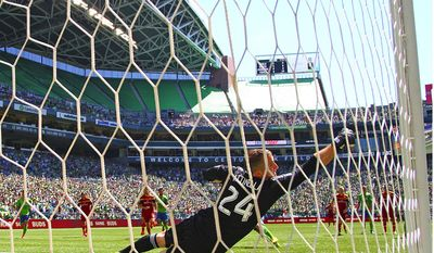 Real Salt Lake goalkeeper Jeff Attinella can't cover a penalty kick by Sounders FC's Gonzalo Pineda in the 42nd minute in an MLS match at CenturyLink Field on Saturday, May 31, 2014, in Seattle, Wash. Sounders FC won, 4-0. (AP Photo/The Seattle Times, John Lok)