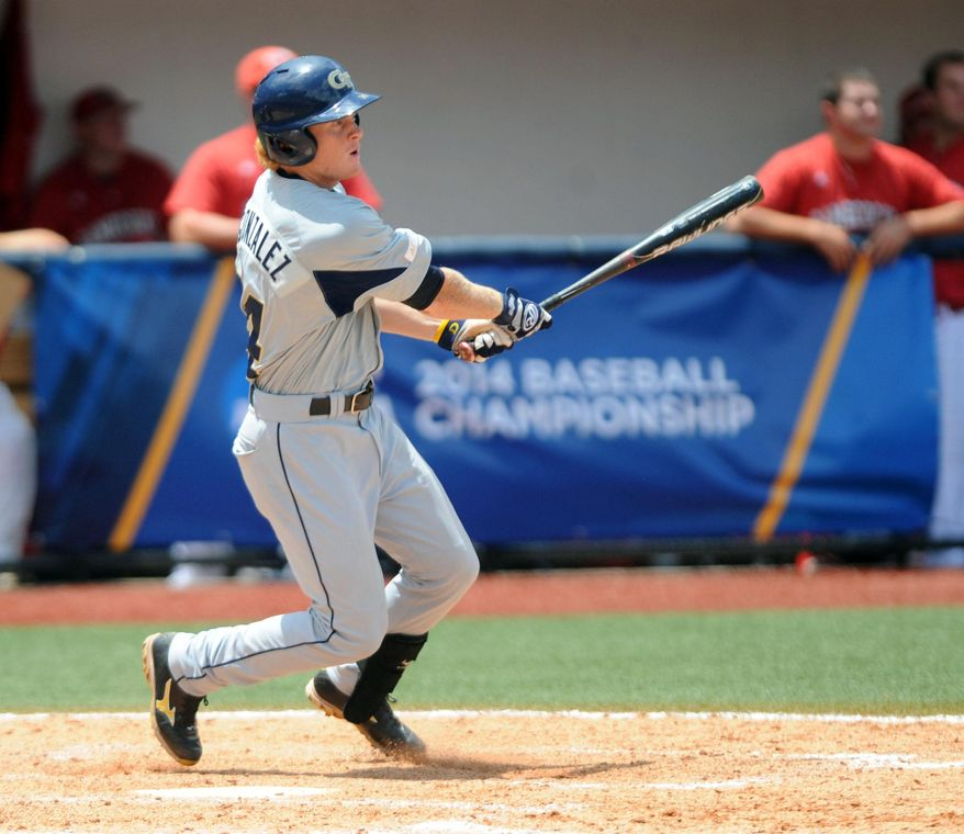 Georgia Tech's Matt Gonzalez (14) hits a two-run double in the top of the 9th inning against Jacksonville State at the NCAA Oxford Regional at Oxford-University Stadium on Sunday, June 1, 2014.  (AP Photo/Oxford Eagle, Bruce Newman)