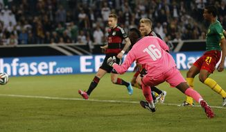 Germany's Andre Schuerrle, second from right, scores during a friendly WCup preparation soccer match between Germany and Cameroon in Moenchengladbach, Germany, Monday, June 2, 2014. (AP Photo/Frank Augstein)