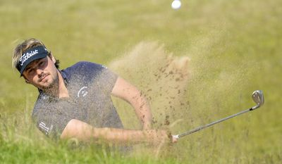 Victor Dubuisson of France hits out of a bunker on the 14th hole during the final round of the Nordea Masters at PGA National, in Malmo, southern Sweden, Sunday, June 1, 2014. (AP Photo/TT, Anders Wiklund) SWEDEN OUT