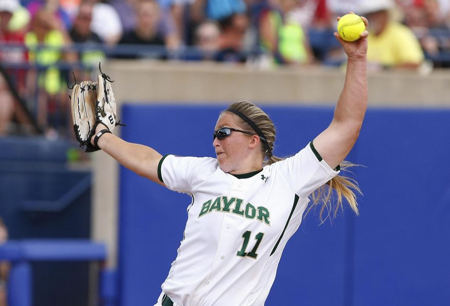 Baylor starting pitcher Whitney Canion works against Florida during the first inning of an NCAA women's softball College World Series tournament game, Sunday, June 1, 2014, in Oklahoma City. (AP Photo/Alonzo Adams)