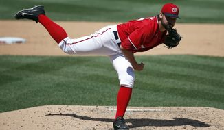Washington Nationals starting pitcher Tanner Roark (57) throws during the fifth inning of a baseball game against the Texas Rangers at Nationals Park, Sunday, June 1, 2014, in Washington. (AP Photo/Alex Brandon)