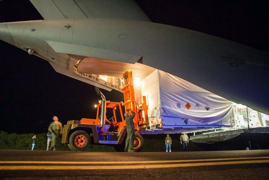 ** FILE ** This April 17, 2014, image provided by NASA shows workmen unloading a saucer-shaped test vehicle for NASA's Low-Density Supersonic Decelerator (LDSD) project, at the U.S Navy's Pacific Missile Range Facility at Kekaha on the island of Kaua'i in Hawaii. (AP Photo/NASA)