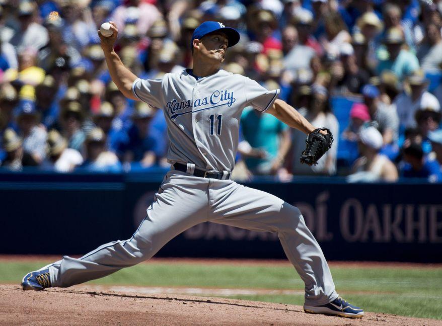 Kansas City Royals starting pitcher Jeremy Guthrie works against the Toronto Blue Jays during the first inning of a baseball game in Toronto on Sunday, June 1, 2014. (AP Photo/The Canadian Press, Nathan Denette)