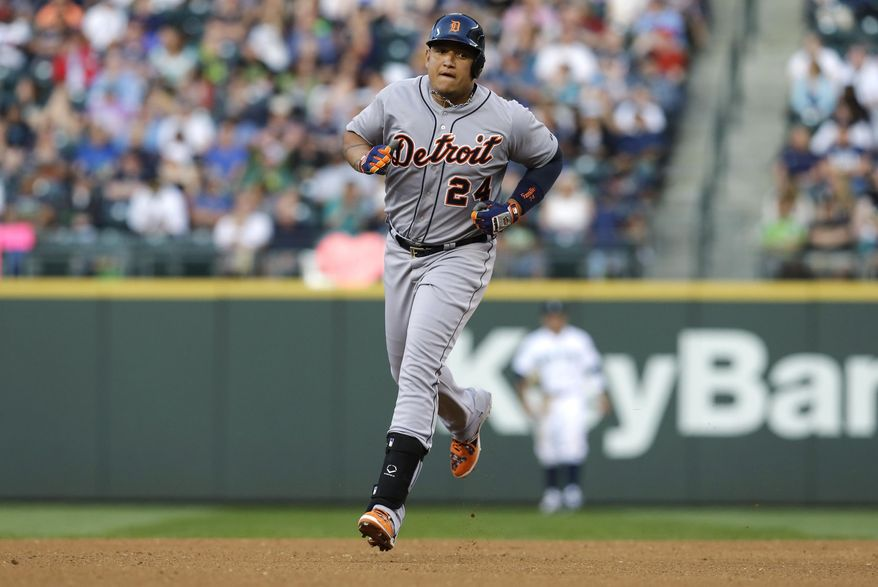 Detroit Tigers' Miguel Cabrera rounds the bases after he hit a home run in the fourth inning of a baseball game against the Seattle Mariners, Saturday, May 31, 2014, in Seattle. (AP Photo/Ted S. Warren)