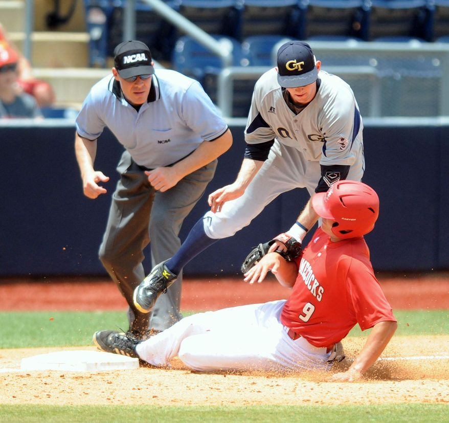 Jacksonville State's Michael Bishop (9) is tagged out at third by Georgia Tech's Brandon Gold (10) as umpire Billy van Raaphorst makes the call at the NCAA Oxford Regional at Oxford-University Stadium on Sunday, June 1, 2014.  (AP Photo/Oxford Eagle, Bruce Newman)