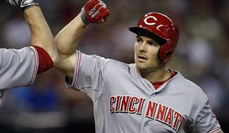 Cincinnati Reds left fielder Chris Heisey (28) celebrates after hitiing a solo home run against the Arizona Diamondbacks in the fith inning during a baseball game, Sunday, June 1, 2014, in Phoenix. (AP Photo/Rick Scuteri)