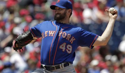 New York Mets starting pitcher Jonathon Niese throws against the Philadelphia Phillies in the first inning of a baseball game Sunday, June 1, 2014, in Philadelphia. (AP Photo/H. Rumph Jr.)