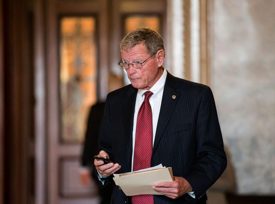 ** FILE ** In this Sept. 25, 2013, file photo, Sen. James Inhofe, R-Okla., the ranking member of the Senate Armed Services Committee, leaves the Senate building. (AP Photo/J. Scott Applewhite, File)'