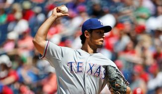 Texas' Yu Darvish struck out 12 in the Rangers' 2-0 win Sunday at Nationals Park. (associated press)
