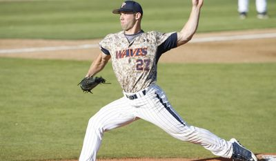 Pepperdine pitcher Aaron Brown delivers in the first inning of an NCAA college baseball tournament regional game against Cal Poly on Saturday, May 31, 2014,  in San Luis Obispo, Calif. (AP Photo/Aaron Lambert)