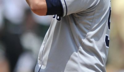San Diego Padres starting pitcher Eric Stults reacts after giving up a solo home run to Chicago White Sox's Tyler Flowers during the fifth inning of an inter league baseball game in Chicago, Sunday, June 1, 2014. (AP Photo/Paul Beaty)