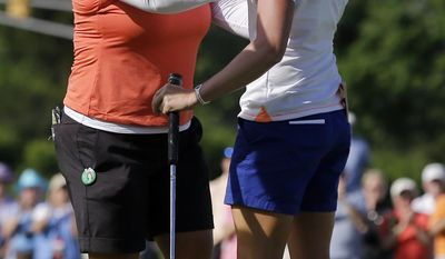 Stacy Lewis, right, is congratulated by Christina Kim after winning the ShopRite LPGA Classic golf tournament in Galloway Township, N.J., Sunday, June 1, 2014. (AP Photo/Mel Evans)