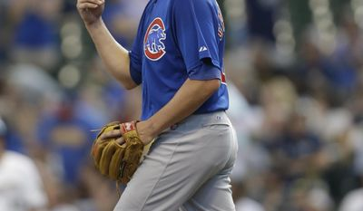 Chicago Cubs starting pitcher Jeff Samardzija tosses the ball up after giving up a three-run triple to Milwaukee Brewers' Lyle Overbay in the third inning of a baseball game on Sunday, June 1, 2014, in Milwaukee. (AP Photo/Jeffrey Phelps)