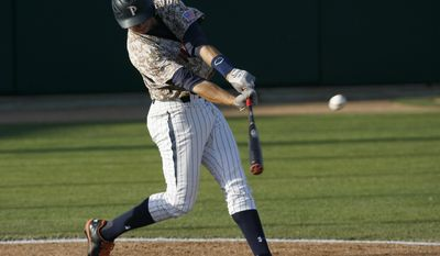 Pepperdine first baseman Brad Anderson connects with the ball during the second inning of an NCAA college baseball tournament regional game against Cal Poly on Saturday, May 31, 2014, in San Luis Obispo, Calif. (AP Photo/Aaron Lambert)