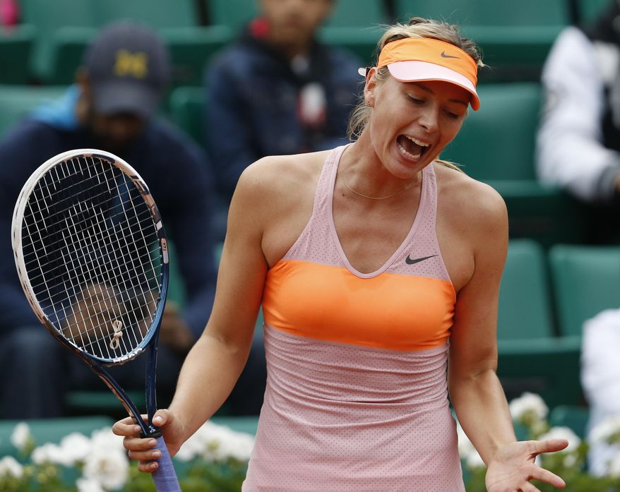 Russia's Maria Sharapova reacts as she plays Australia's Samantha Stosur during their fourth round match of  the French Open tennis tournament at the Roland Garros stadium, in Paris, France, Sunday, June 1, 2014. (AP Photo/Darko Vojinovic)