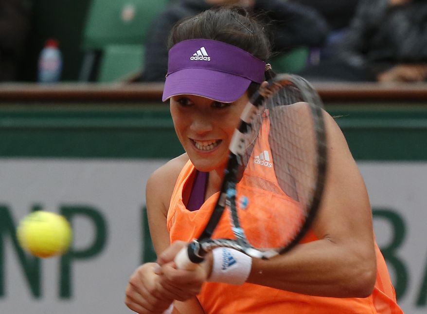Spain's Garbine Muguruza returns the ball during the fourth round match of the French Open tennis tournament against France's Pauline Parmentier at the Roland Garros stadium, in Paris, France, Sunday, June 1, 2014.  (AP Photo/Michel Euler)