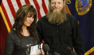 Jani and Bob Bergdahl speak to the media during a news conference at Gowen Field in Boise, Idaho, on Sunday, June 1, 2014. Their son, Sgt. Bowe Bergdahl is back in American hands, freed for five Guantanamo terrorism detainees. (AP Photo/Otto Kitsinger)